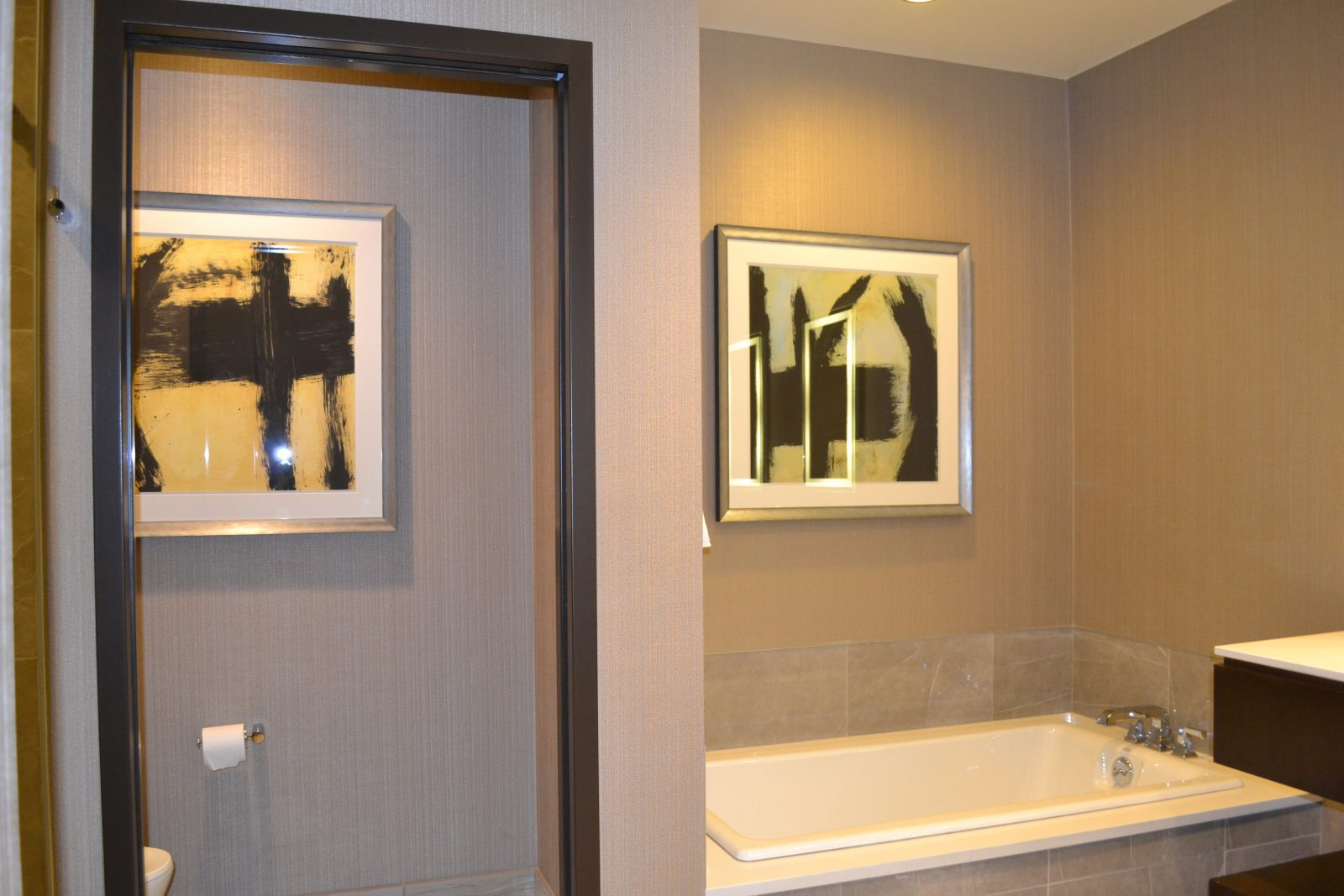 framed artwork in a bathroom
