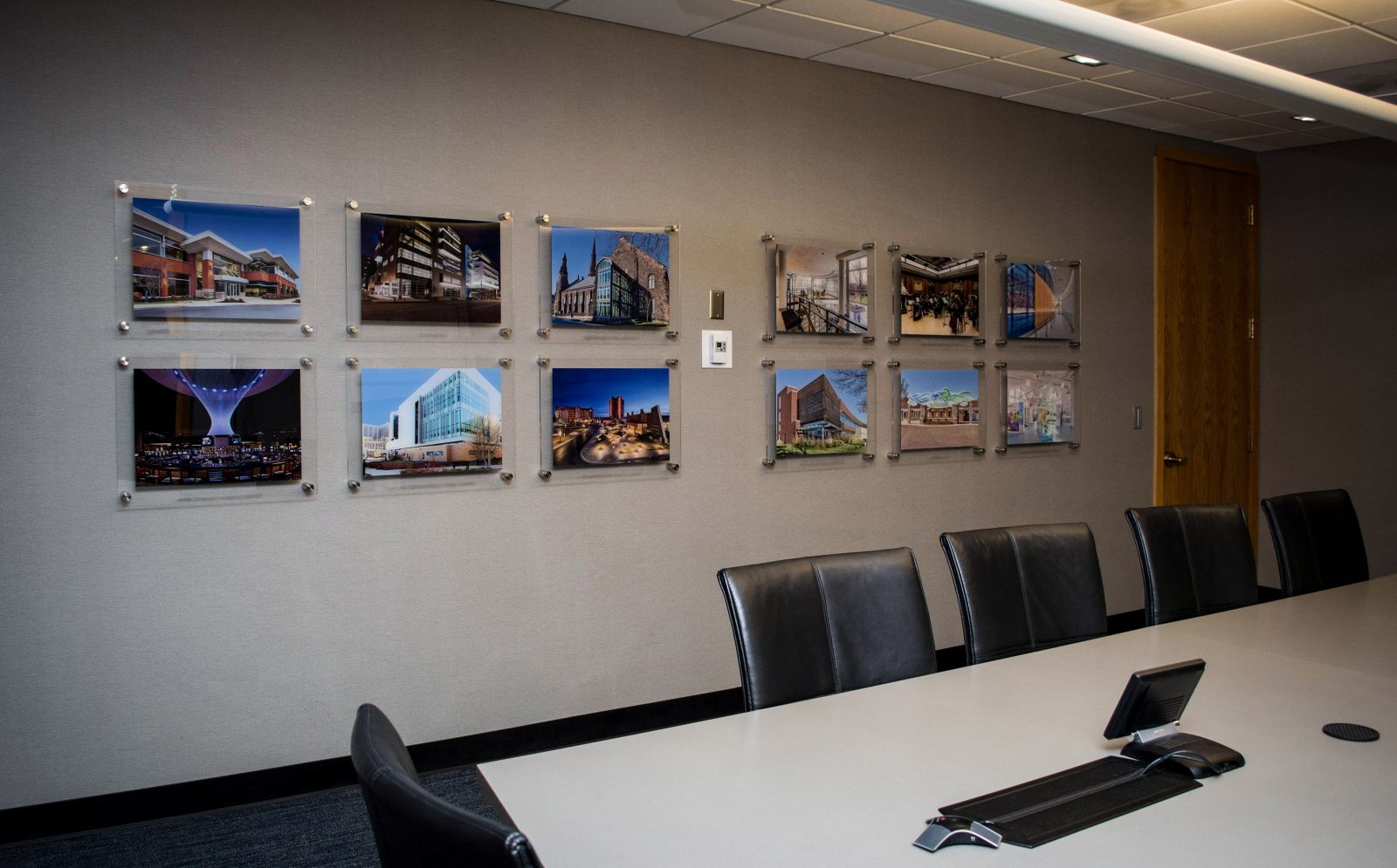 framed photos on the wall of a conference room