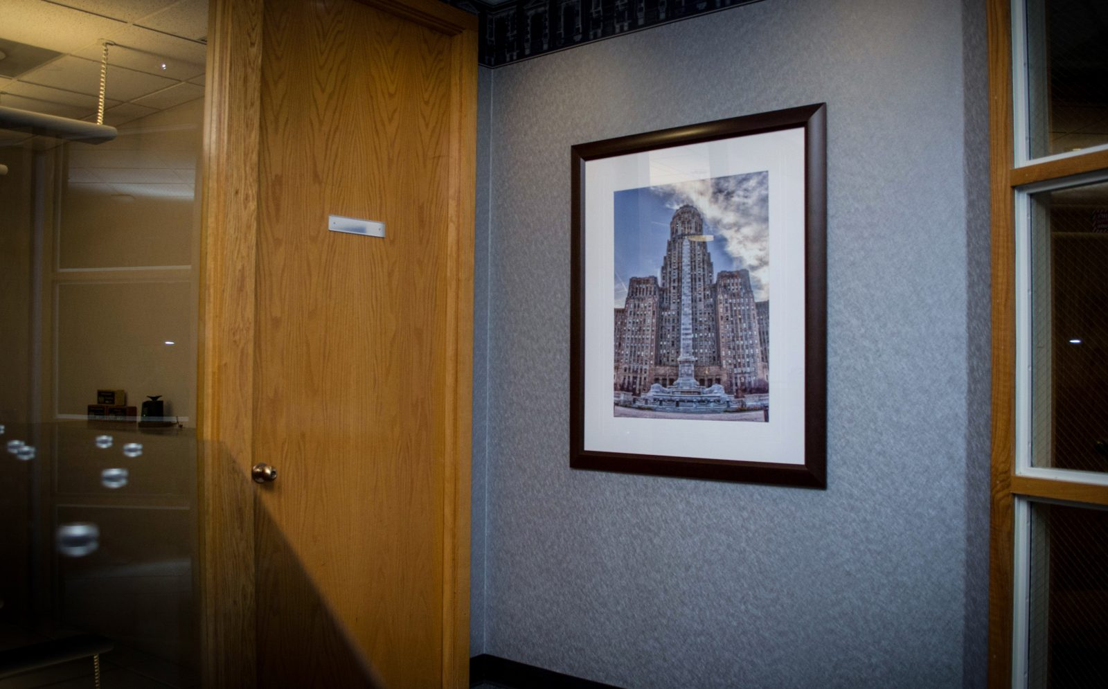 a framed photograph of a high rise building