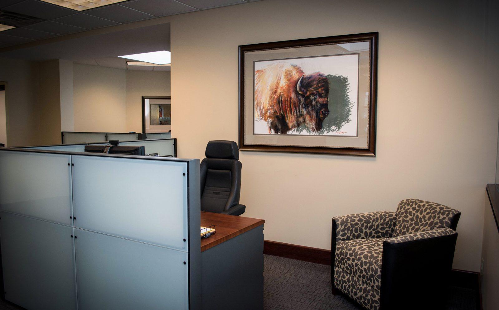 framed buffalo artwork on the wall of an office