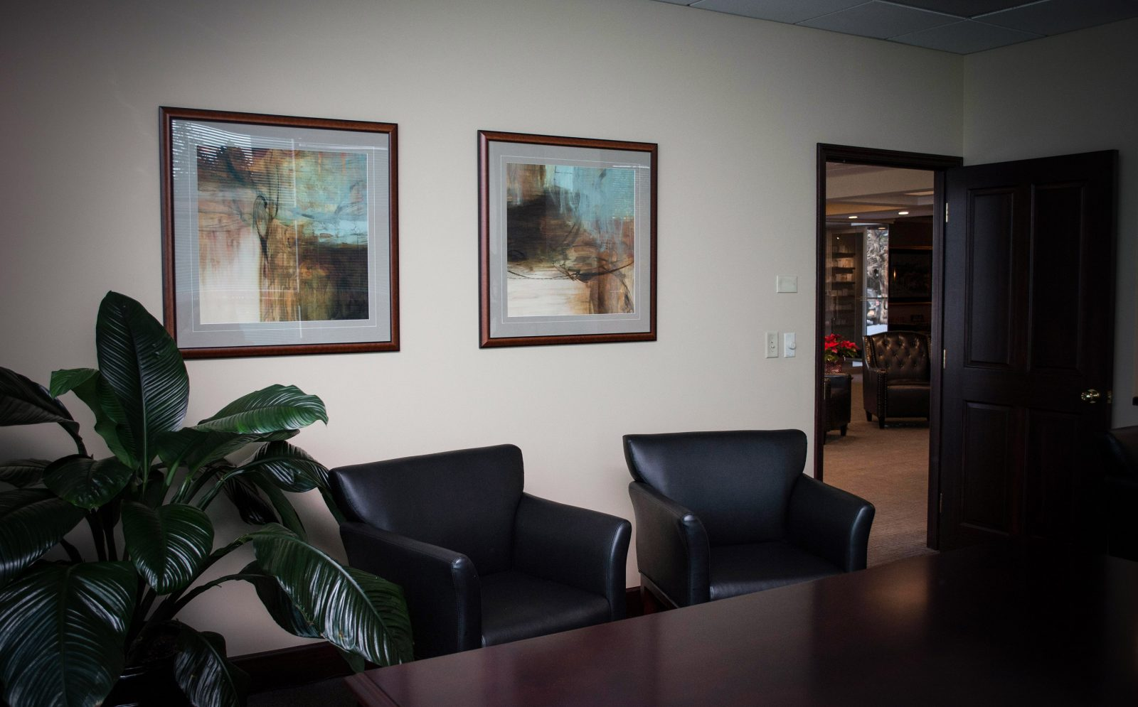 framed artwork in an office building with the door open