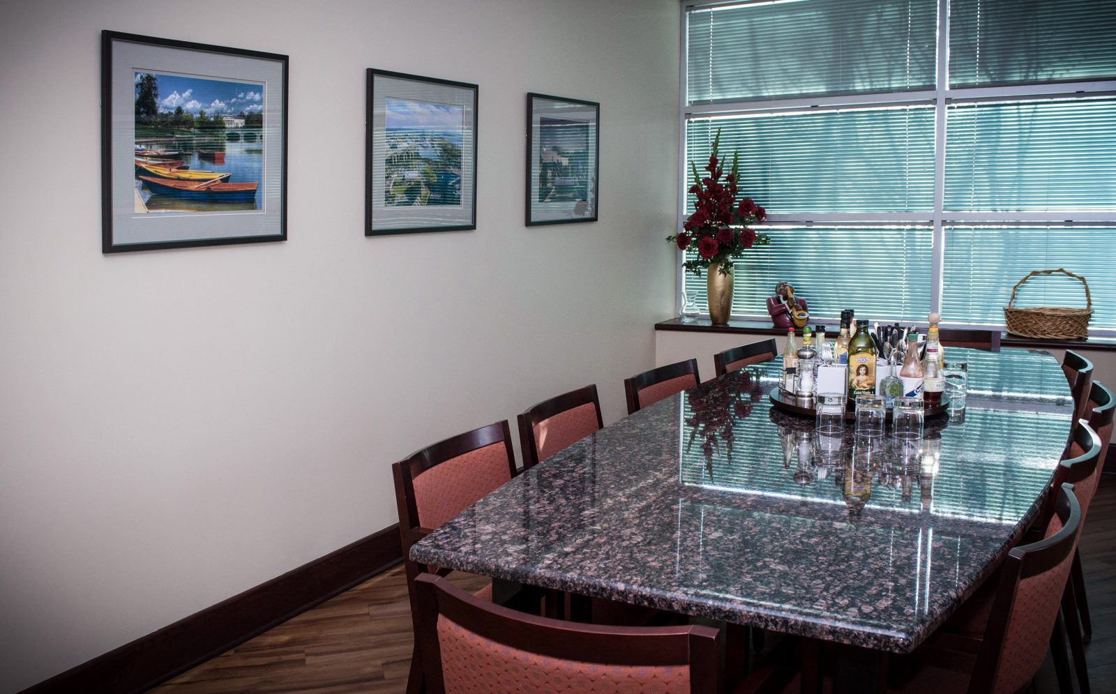 framed artwork on the wall of a conference room with a drink tray on the table