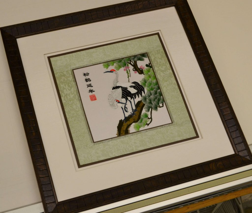 Embroidered silk, framed with fabric matte