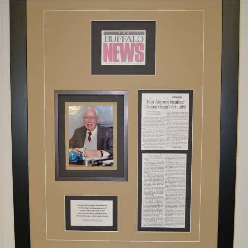 Framed newspaper article with fillet and double mattes