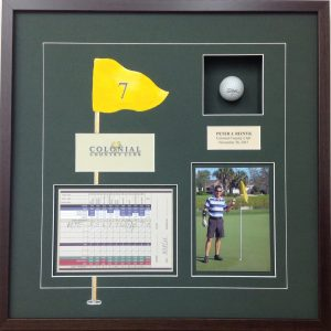 Framed golf hole in one scorecard and photos
