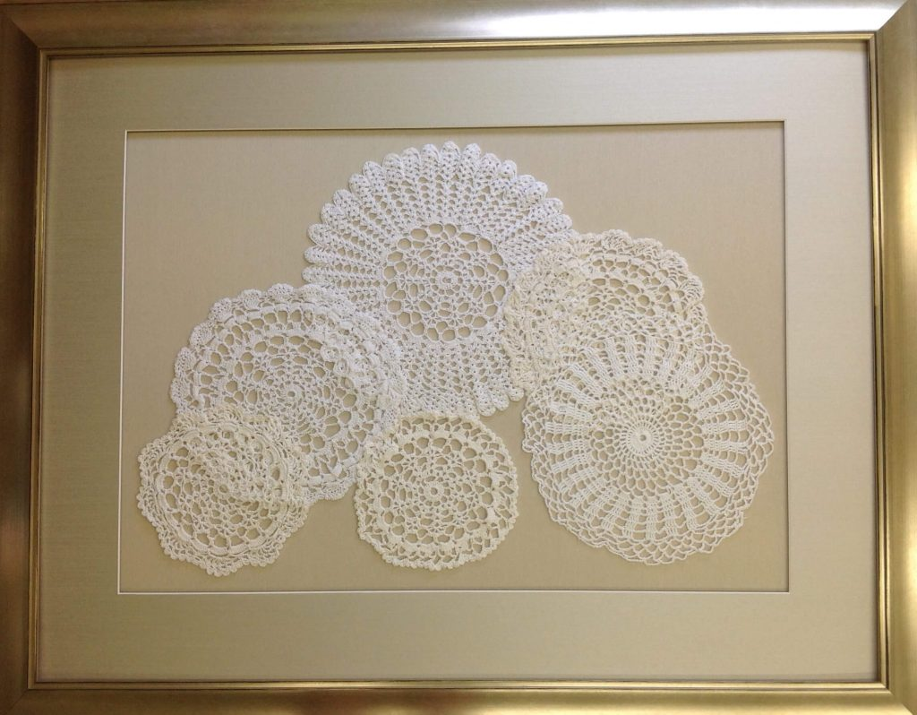 Lace mounted on matte board spaced and framed