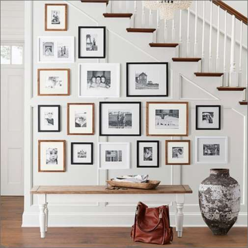 A wall full of framed photos
