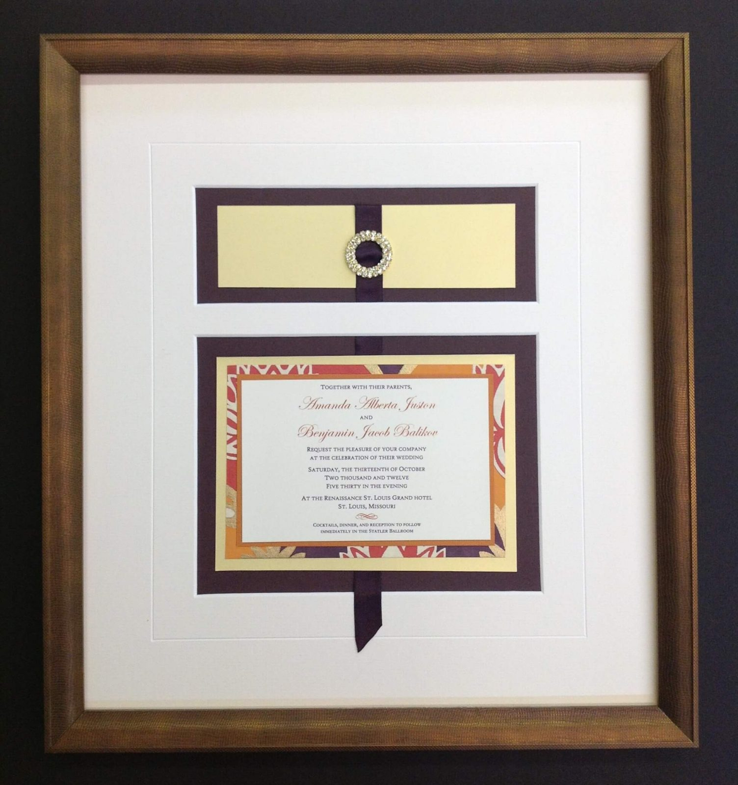 A wedding invitation framed and matted