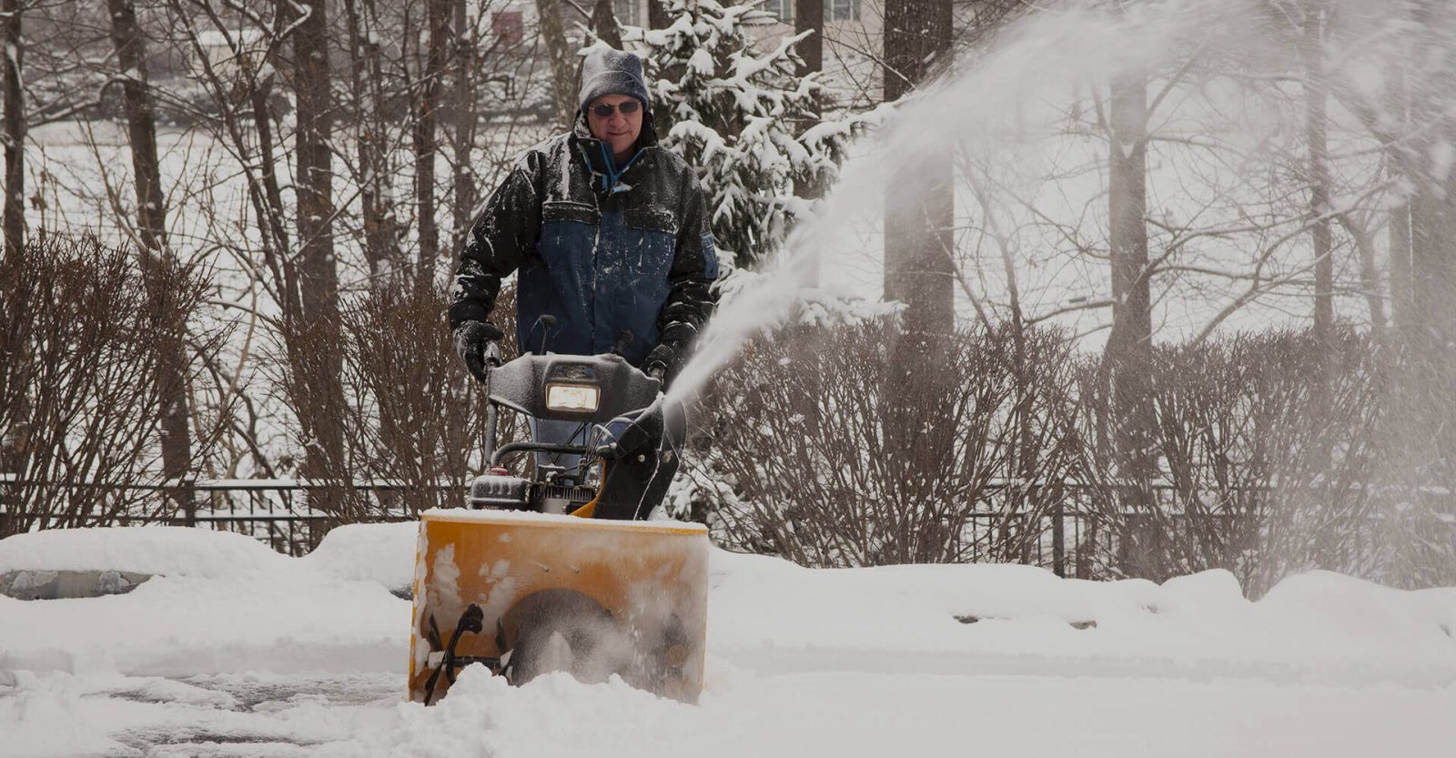 A snowblower clearing a driveway