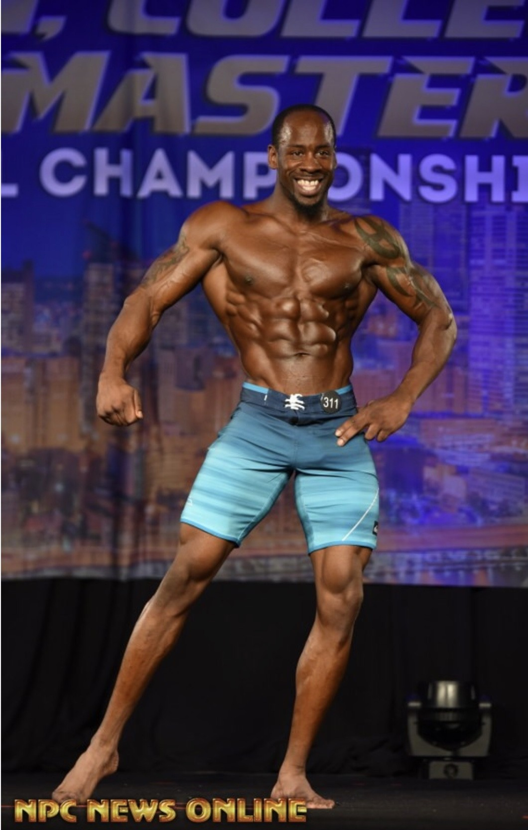 Derick posing at a competition