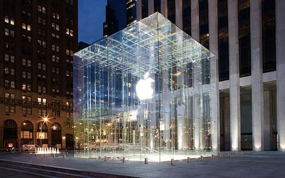 A glass building with the apple logo on it