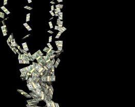 Dollar bills falling through the air
