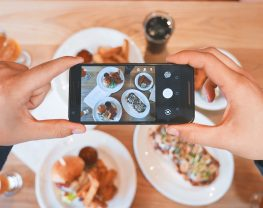 picture of someone taking a photo of plates of food
