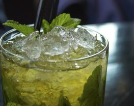 A drink with ice and mint leaves