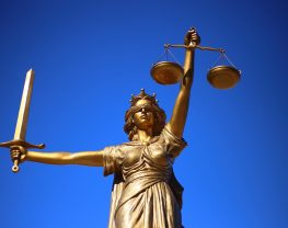 Justice statue holding a sword and scale