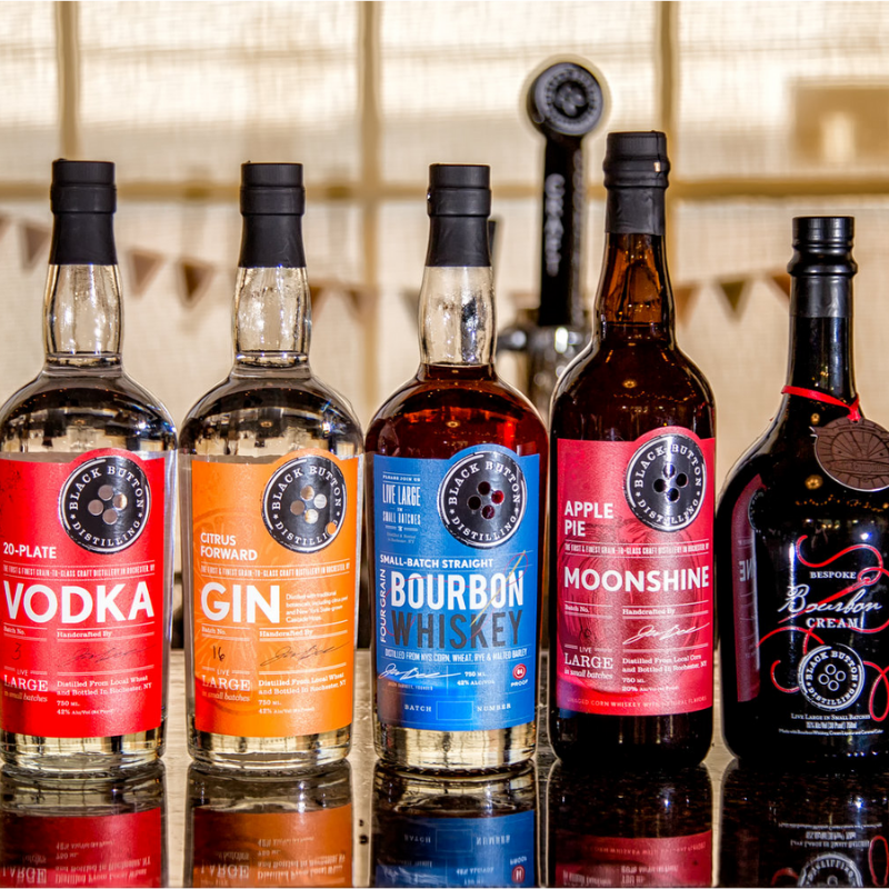 bottles of black button distilling products
