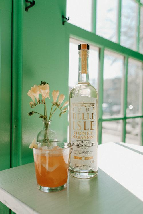 a bottle of belle isle moonshine