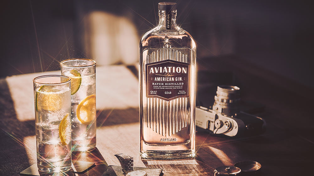 a bottle of aviation gin on a table